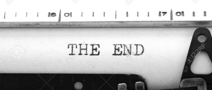 Typewriting on an old typewriter. Typing text: the end
